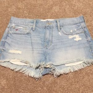 Mid rise distressed jean shorts